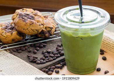 Iced Matcha green tea in takeaway cup. Glass of green tea smoothies with fresh green tea. Homemade Iced Matcha Latte Tea with Milk.