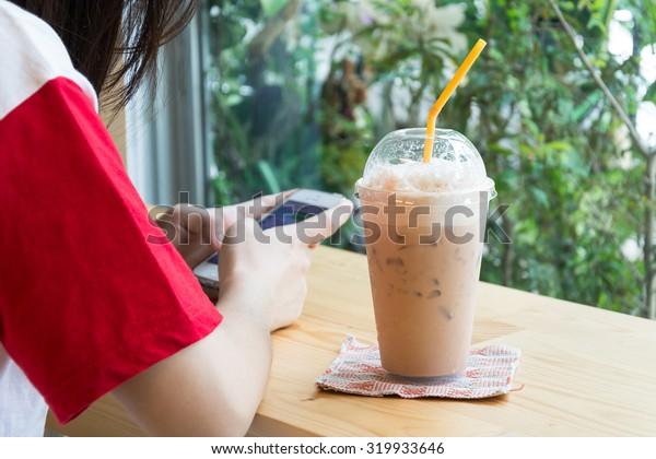 iced milk tea on wood table