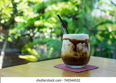 Iced Mocha Coffee With Chocolate Syrup, bokeh background