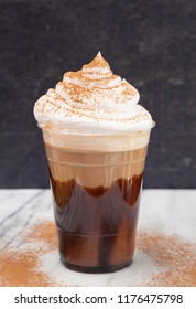 Iced Mocha in a Disposable Plastic Cup with Whipped Cream