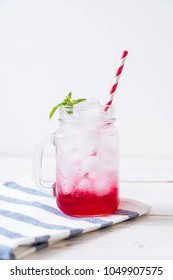 iced strawberry soda on wood table