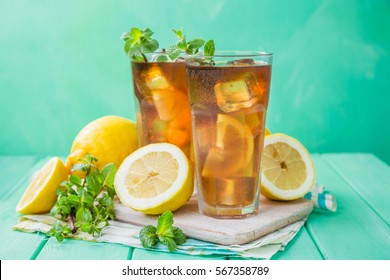 Iced tea in glasses, summer background copy space