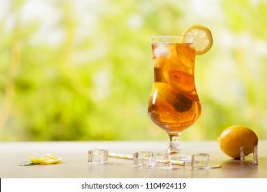 Iced tea with lemon and ice cubes.