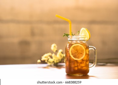 Iced tea with lemon and mint on wooden counter bar,  loft and rustic style. - Shutterstock ID 668388259