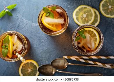 Iced tea with lemon and mint overhead shot