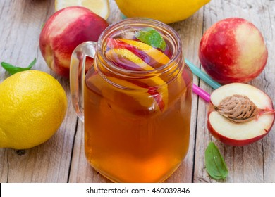 Iced tea with lemon and peach in a Mason jar. Selective focus