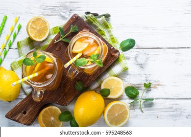 Iced tea with lemon. Refreshment cold summer drink. Top view.
