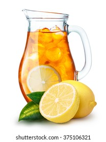 Iced tea in a pitcher. Jug full of iced tea or lemonade with lemons on foreground