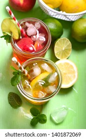 Iced tea, summer refreshment fruit drink or cocktails with peach and lime