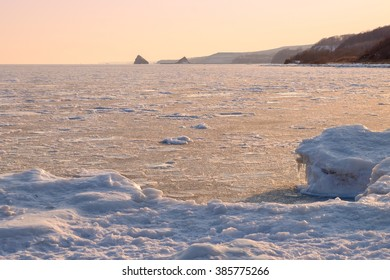 iced water gold sunset