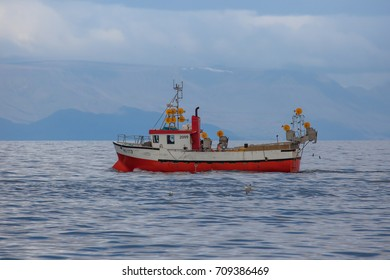 Iceland - August 16, 2017 : Commercial fishing boat Islandsbersi HU-113 at mackerel fishing near the south-west coast of Iceland.