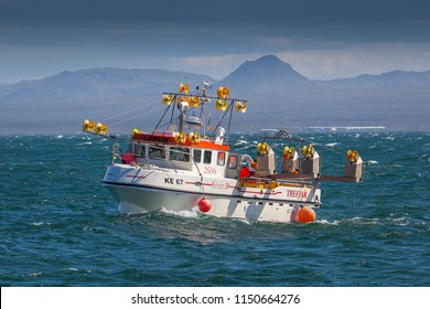 Reykjanesbær / Iceland - August 6, 2018 : Mackerel fishing boat 2606 Lómur KE-67 fishing for mackerel near the southwest coast of Iceland.