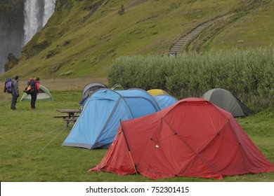 iceland - camping in nature near a waterfall - skogafoss