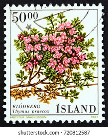 "ICELAND - CIRCA 1988: A stamp printed in Iceland from the ""Flowers"" issue shows Mother of Thyme (Thymus praecox), circa 1988."