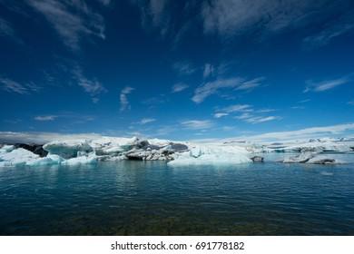 Iceland - Deep blue sky over floating ice blocks on glacier lagoon