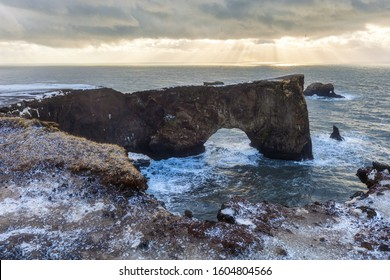 Iceland dyrholaey rock arch, winter in Iceland, dyrholaey arch in winter, storm in the ocean