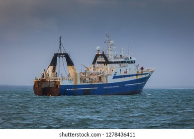 Iceland - February 15, 2012 : Factory trawler Saputi owned by the Qikiqtaaluk Corporation sailing near shore of south west Iceland.