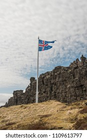 Iceland Flag flying in Thingvellir/Þingvellir National Park at the site of Althing, the oldest parliament in the world.