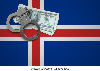Iceland flag  with handcuffs and a bundle of dollars. The concept of breaking the law and thieves crimes