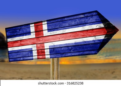 Iceland Flag wooden sign on beach background