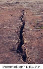Iceland ground surface in Iceland with rift, deep crack in the rock