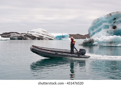 Iceland: guide on a boat in Jokulsarlon glacier lagoon on August 9, 2012. Jokulsarlon is a glacial lake in Vatnajokull National Park developed after the glacier receded from the edge of Atlantic Ocean