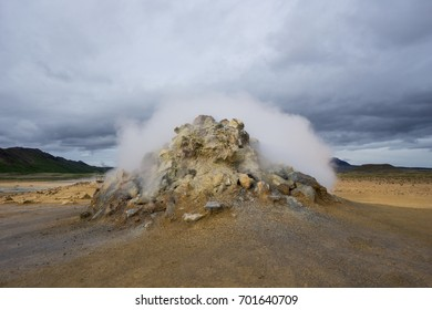 Iceland - Hydrogen sulfide and gas fizzing out of an active fumarole in geothermal area of hverir