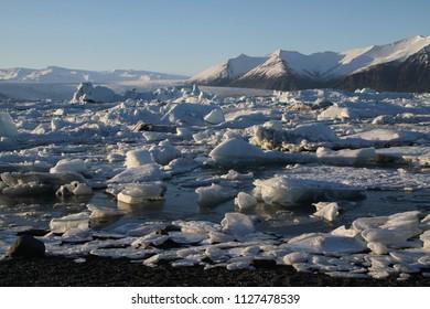 Iceland, Jokulsarlon lagoon, Beautiful cold landscape picture of icelandic glacier lagoon bay. Icebergs in Jokulsarlon glacial lagoon. Vatnajokull National Park, southeast Iceland, Europe.