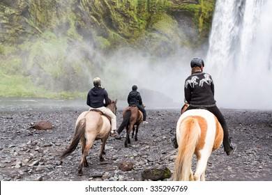 Iceland - June 19, 2015: Horseback riding at Skogafoss Waterfall, Iceland.