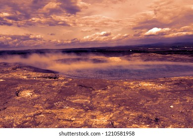 Iceland landscape. Steaming geothermal sources water. Famous geologic features and natural phenomena