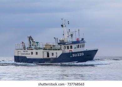 Iceland - March 26, 2013 : Commercial fishing boat 2400 Hafdis SU-220 sailing near the south-west coast of Iceland in calm Atlantic ocean.