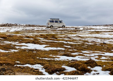 ICELAND - May 1, 2016 : Old van on a deep snow under heavy snow, way to the glacier Fjallsarlon, Winter off road driving in Iceland
