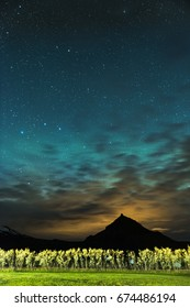 Iceland mountain with warm brown clouds and cold teal night sky