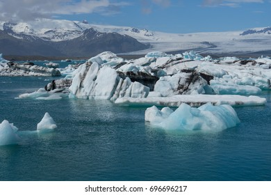 Iceland - Numerous ice floes before giant glacier mountains