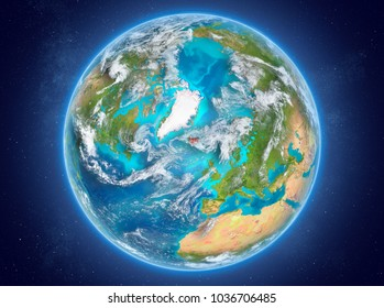 Iceland in red on model of planet Earth with clouds and atmosphere in space. 3D illustration. Elements of this image furnished by NASA.