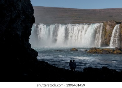 """ICELAND - SEPTEMBER 5: Taking selfie in front of  Godafoss or """"waterfall of the gods"""" as seen on 5. 9. 2016 in Northeastern Iceland. Godafoss is 12 meters high and 30 meters wide."""