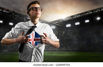 Iceland soccer or football supporter showing flag under his business shirt on stadium.