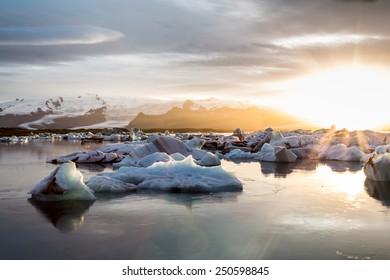 Iceland, sunset over Jokulsarlon Glacier Lagoon, Icebergs floating with the last light, amazing outdoor landscape.
