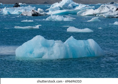 Iceland - Turquoise crystal clear ice floes moving towards ocean