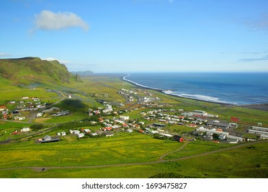 ICELAND, VIC - JUNE 25, 2019: Summer walk in the vicinity of the town of Vic, view of the city from the mountain - Shutterstock ID 1693475827