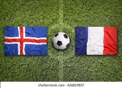 Iceland vs. France flags on green soccer field