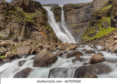 Iceland waterfall with a small river