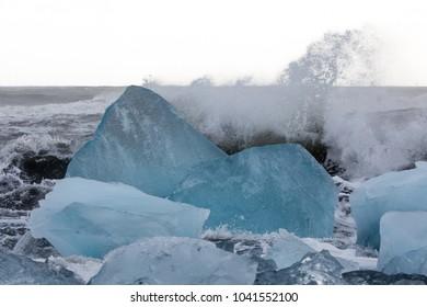 Iceland, waves crashing on icebergs