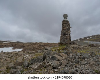 Iceland, West fjords, Isafjordur, June 25, 2018: Big Kleifabui Statue made from natural stones at Kleifaheidi Pass, West Fjords, Iceland, gray sky and granite rocks