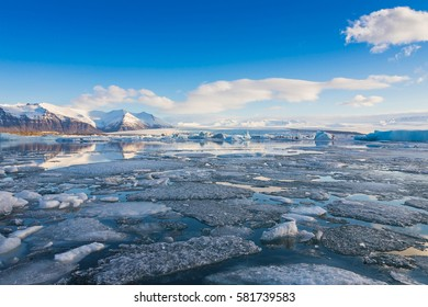 Iceland winter lake with blue sky, natural landscape background in winter season