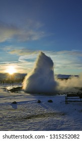Icelandic active geyser spouting at sunrise.