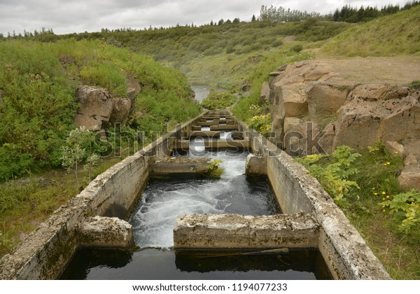 Icelandic dam nearby fall