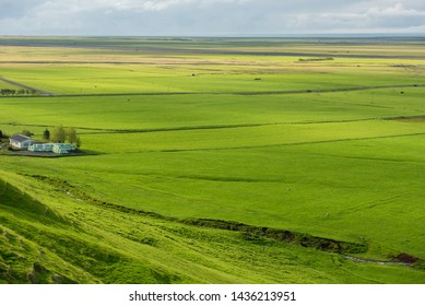 Icelandic farm houses in the middle of a green countryside plain. Skogar, Iceland