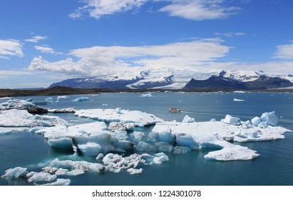 Icelandic glacial lagoon - Jökulsárlón is a large glacial lake in  Iceland. ear the icebergs floating boat with tourists.