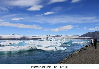 The Icelandic glacial lagoon-Jökulsárlón-is a large glacial lake in Iceland. Tourists see the lake from the shore.